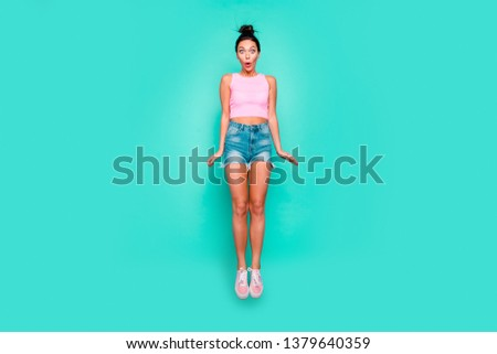 Full length body size photo beautiful she her jump high not believe eyes so big great success trendy stylish hairdo wear casual pink tank-top jeans denim shorts isolated teal turquoise background