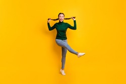 Full length body size photo childish playful girl dancing relaxing on weekend enjoying music isolated on vibrant yellow color background