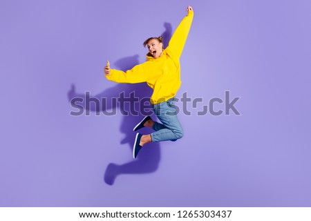 Full length body size photo of beautiful cheer brunette she her lady with pretty buns hairdo yelling in skype make take selfies glad wearing casual jeans yellow pullover isolated on purple background