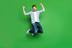 Full length body size photo of cheerful crazy ecstatic guy rejoicing with his favorite sport team having won competitions isolated jumping isolated over green vivid color background