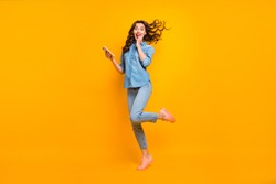 Full length body size photo of cheerful crazy sweet pretty girlish feminine youngster overjoyed about having received long expected message holding phone expressing emotions isolated color background