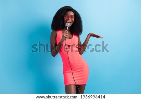 Full length body size photo of curious woman performing on stage lookng empty space isolated on bright blue color background Photo stock ©