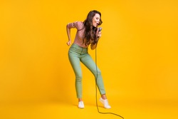 Full length body size photo of female pop star singing song on stage festival isolated on bright yellow color background