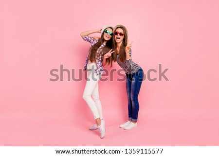 Full length body size photo of funny crazy childish people having caps weekends rest holidays making v-signs laughing isolated wear jeans checkered blouses on pastel background
