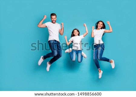 Full length body size photo of funny funky trendy lucky fortunate family triumphing while isolated with blue background