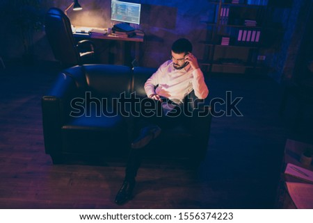 Full length body size photo of pensive interested man looking pensively into laptop screen in search of bugs to be fixed finding code issues