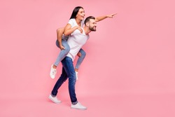 Full length body size photo of rejoicing nice cute couple behaving like being one and the same while isolated with pastel background