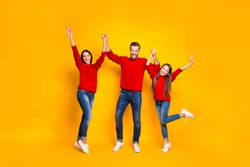 Full length body size photo of rejoicing screaming cheerful positive friendly family loving each other with emotional facial red sweaters expression isolated over vivid color yellow background