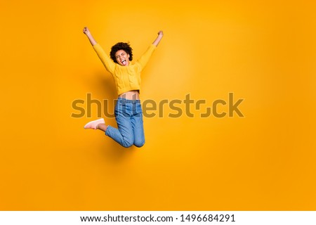 Full length body size photo of trendy curly wavy pretty screaming girlfriend shouting wearing jeans denim pullover isolated over vivid color background