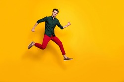Full length body size photo of turned running jumping crazy man enjoying his run in shoes for sales in trousers isolated vivid color background