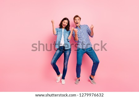 Full length body size photo of two dance floor she her he him his pair yelling in voice rock and roll song fists raised casual jeans denim shirts plaid shirts isolated on rose background
