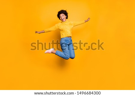 Full length body size photo of wavy curly careless charming pretty girlfriend black skinned rejoicing with sales starting wearing jeans denim pullover isolated over vivid color background