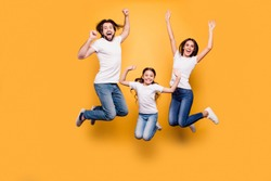 Full length body size portrait of nice lovely adorable attractive positive cheerful people dad daddy mom mommy spending spare free time isolated over shine vivid pastel yellow background