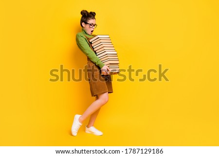 Full length body size profile side view of her she attractive overwhelmed intellectual girl carrying many book science isolated bright vivid shine vibrant yellow color background Сток-фото ©