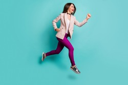 Full length body size profile side view of nice attractive cheerful cheery sportive straight-haired girl jumping running isolated on bright vivid shine vibrant blue green turquoise color background