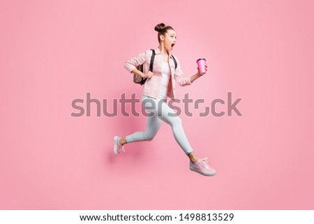 Full length body size profile side view portrait of her she nice attractive charming lovely shine slender worried girl running fast late first lecture isolated over pink pastel background