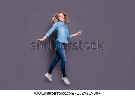 Full length body size profile side view portrait of her she nice cute charming lovely attractive carefree cheerful wavy-haired lady having fun isolated over gray purple violet pastel background #1329219884
