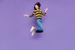 Full length body size side profile photo beautiful amazing she her lady jump high flight party person people playful mood wear blue yellow striped pullover isolated violet purple background