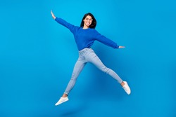 Full length body size side profile photo young woman jumping up careless isolated vibrant blue color background