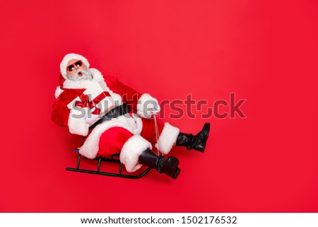 Full length body size view of amazed stunned kind funky fat overweight plump gray-haired bearded man sledging carrying bow ribbon purchase isolated over bright vivid shine red background