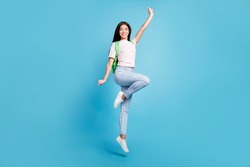 Full length body size view of attractive cheerful teen girl jumping going to high school isolated over bright blue color background