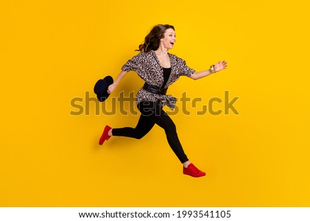 Full length body size view of attractive chic slim fashionable cheerful girl jumping running isolated on shine yellow color background