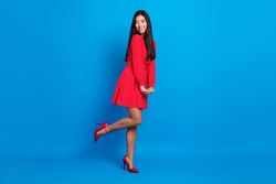 Full length body size view of attractive shy cheerful lady posing good mood isolated over vivid blue color background