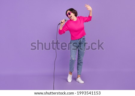 Full length body size view of attractive talented woman singing hit voice isolated over violet purple color background