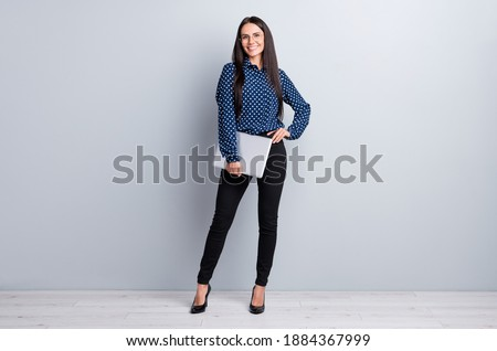 Full length body size view of charming smart skilled tall cheerful girl posing carrying laptop isolated on grey pastel color background Stock foto ©