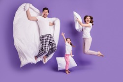 Full length body size view of cheerful glad carefree funny family small little daughter jumping having fun bedtime weekend isolated on bright vivid shine vibrant violet color background