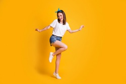 Full length body size view of fit cheerful brown-haired girl jumping dancing enjoying free time isolated over bright yellow color background