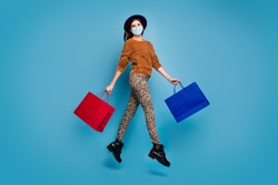 Full length body size view of her she attractive girl wearing safety mask jumping going shopping visit store mall boutique mers cov prevention delivery isolated over bright vivid blue color background