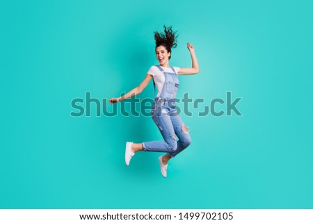 Full length body size view of her she nice attractive cheerful cheery glad carefree girl wearing overall jumping having fun free time isolated on bright vivid shine vibrant green turquoise background #1499702105
