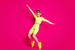 Full length body size view of her she nice attractive fit slim sporty funky cheery funky girl listening music dancing having fun isolated bright vivid shine vibrant pink fuchsia color background