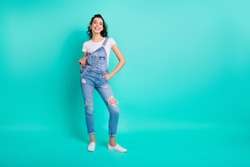 Full length body size view of her she nice attractive lovely pretty cheerful cheery content girl wearing blue overall posing isolated over bright vivid shine vibrant green turquoise background