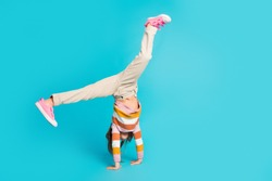 Full length body size view of her she nice attractive sporty talented girl dancing break free time leisure standing on hands isolated over bright vivid shine vibrant blue color background