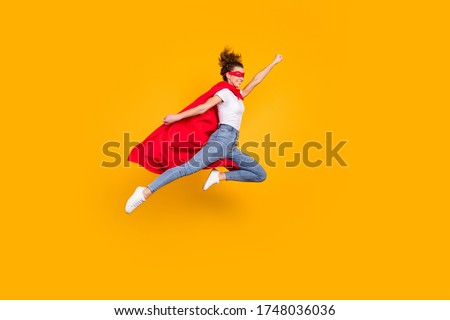 Full length body size view of her she nice attractive strong motivated energetic fit slim cheerful girl jumping wearing cape rescuing earth isolated bright vivid shine vibrant yellow color background Stock foto ©