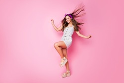 Full length body size view of her she nice-looking attractive charming dreamy cheerful straight-haired girl having fun wind blowing hair good mood weather isolated on pink pastel color background