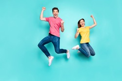 Full length body size view of his he her she nice attractive crazy overjoyed cheerful couple jumping up in air having fun time rejoicing isolated on bright vivid vibrant green turquoise background