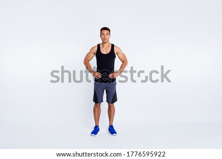 Full length body size view of his he nice attractive content serious sportive guy visiting gym self development hands on hips isolated over gray pastel color background stock photo
