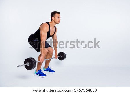 Full length body size view of his he nice attractive content sportive strong focused dedicated guy doing exercise lifting barbell effort isolated over light gray pastel color background