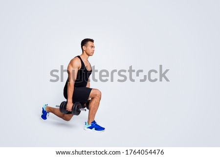 Full length body size view of his he nice attractive muscular sportive guy doing exercise lifting weight power building body isolated over light gray pastel color background