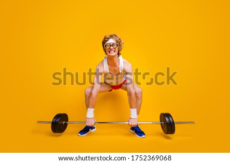 Full length body size view of his he nice funky slim motivated desperate foxy guy lifting barbell doing work out coacher program isolated over bright vivid shine vibrant yellow color background Foto stock ©