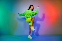 Full length body size view of lovely funky cheery girl dancing clubbing chill out isolated over multicolor vivid neon light background