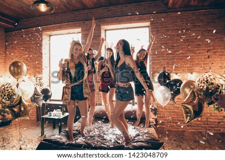 Full length body size view of nice attractive feminine lovely royal cheerful group having fun dancing on bed birthday in open space golden decorated loft industrial style interior room