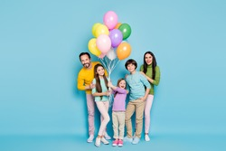 Full length body size view of nice attractive lovely charming cheerful cheery big full family celebrating occasion festal decoration isolated on bright vivid shine vibrant blue color background