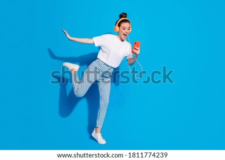 Full length body size view of nice attractive lovely funny funky glad cheerful girl listening soul rock different single dancing having fun isolated on bright vivid sine vibrant blue color background