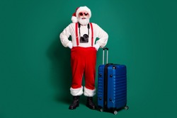 Full length body size view of nice handsome bearded funky cheerful cheery, overweight fat Santa boarding air flight fly departure wearing cam leisure rest isolated over green color background