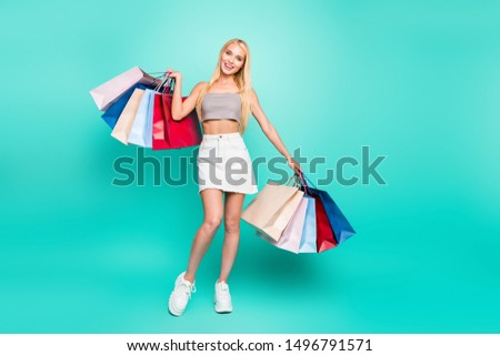 Full length body size view of nice-looking attractive charming slim fit cheerful fascinating straight-haired girl carrying new things isolated on bright vivid shine green turquoise background #1496791571