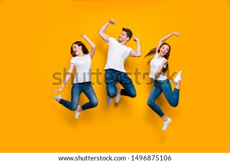 Full length body size view of three nice attractive lovely slim strong sportive sporty cheerful cheery person having fun free time isolated over bright vivid shine yellow background
